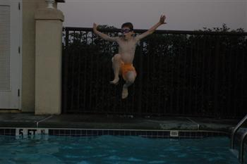 Steven jumping into the pool